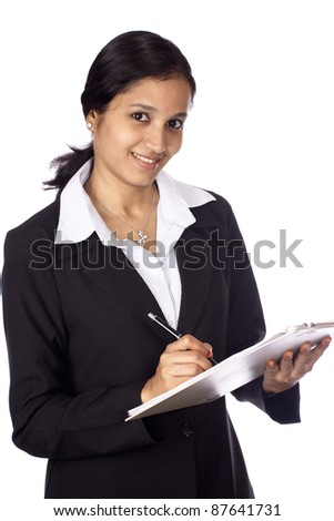 Businesswoman with clip board - stock photo