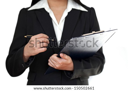 Businesswoman with clipboard and pen - stock photo