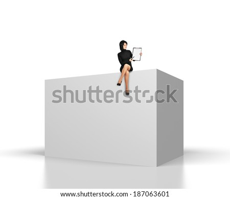businesswoman with clipboard sitting on big cube - stock photo