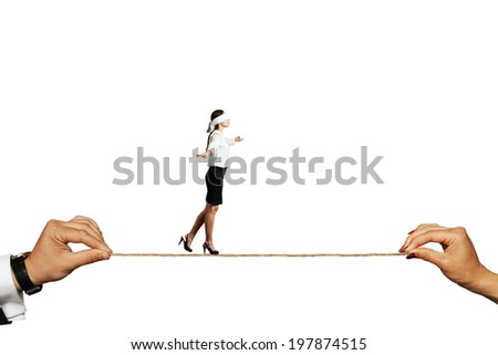 businesswoman with closed eyes balancing on the rope. isolated on white background