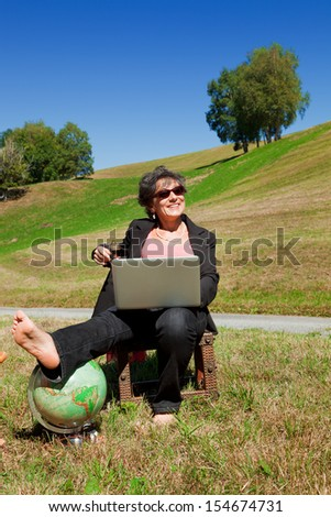 Businesswoman with computer in the park