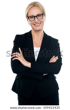 Businesswoman with crossed arms wearing glasses isolated against white background - stock photo