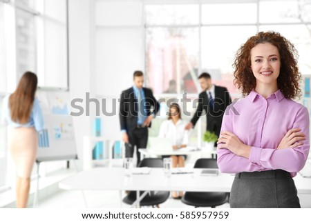 Businesswoman with crossed hands in office