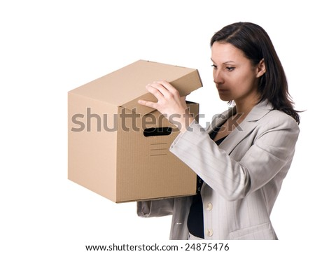 businesswoman with curiosity looks to cardboard box - stock photo