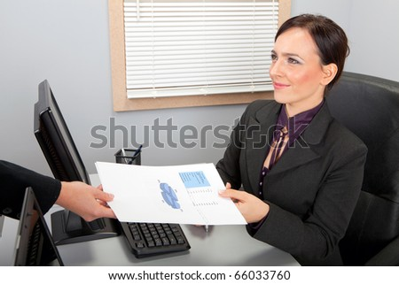 Businesswoman with document in office