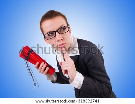 Businesswoman with dynamite on white - stock photo