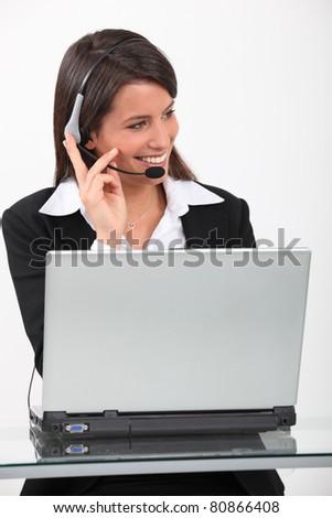 Businesswoman with earphones - stock photo