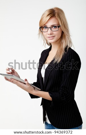 Businesswoman with electronic pad - stock photo