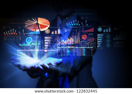 Businesswoman with financial symbols coming from her hand - stock photo