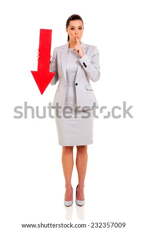 businesswoman with finger on her lips gesturing for quiet - stock photo