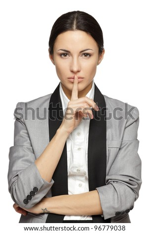 Businesswoman with finger on lips over white background - stock photo