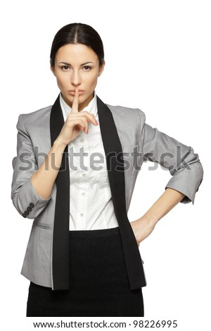 Businesswoman with finger on lips over white background