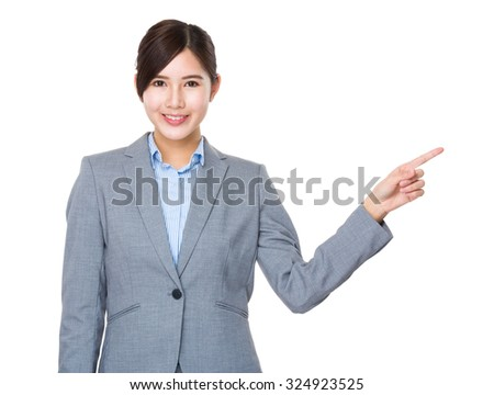 Businesswoman with finger point aisde