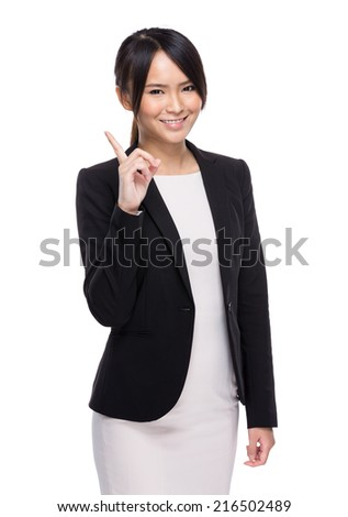 Businesswoman with finger point out - stock photo