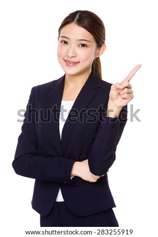 Businesswoman with finger pointing upwards