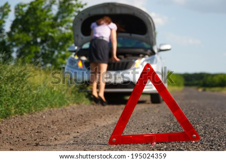 businesswoman with flat tire - stock photo