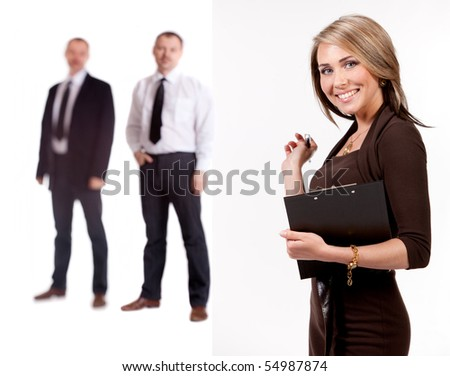 Businesswoman with folder and pen. Behind the two engineers of men in soft focus. On a white background. - stock photo