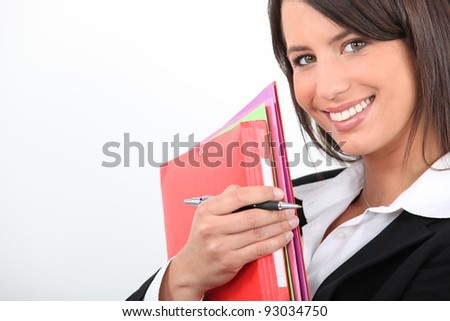 Businesswoman with folders - stock photo