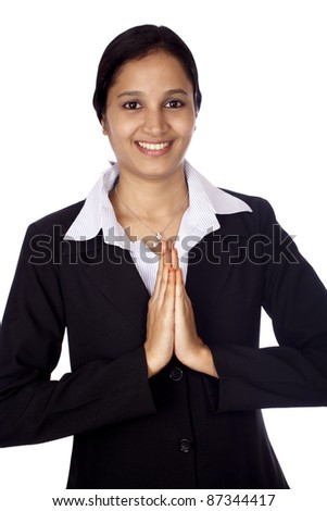 Businesswoman with hands in prayer - stock photo