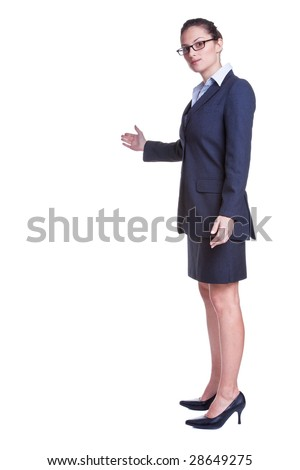 Businesswoman with her arm out in a welcoming gesture, isolated on white background.