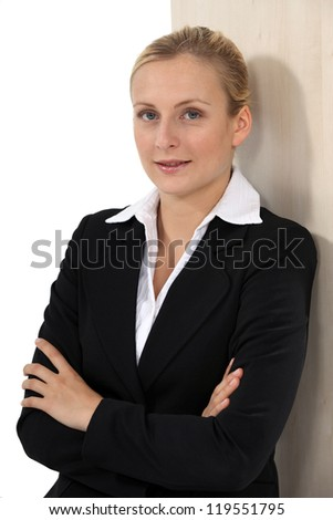 Businesswoman with her arms folded - stock photo