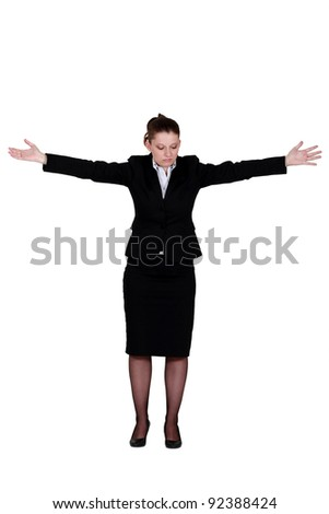 Businesswoman with her arms spread out - stock photo