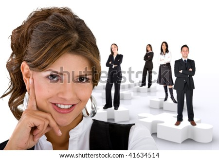 Businesswoman with her teamwork on puzzle pieces isolated on white - stock photo