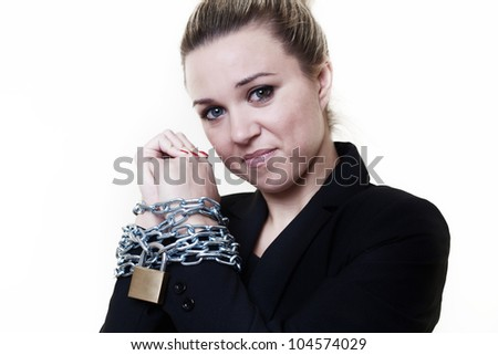 businesswoman with her wrists in chains and locked up - stock photo