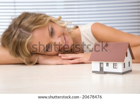businesswoman with house for real estate concept - stock photo