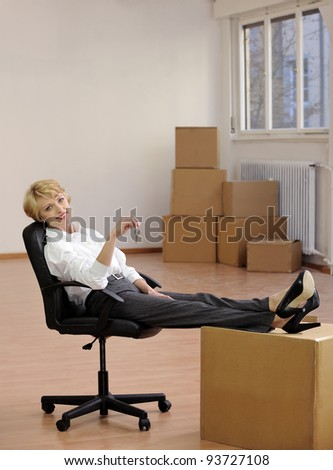 Businesswoman with key to new office smiling - stock photo