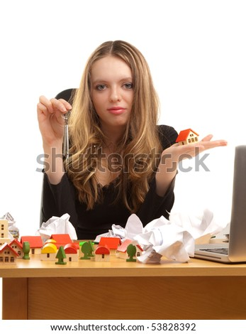 Businesswoman with keys and house on her palm - stock photo