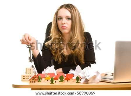Businesswoman with keys in her hand at office - stock photo