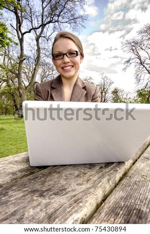 businesswoman with laptop enjoy works outdoor - stock photo