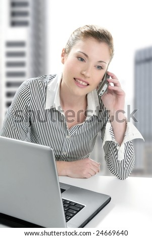 Businesswoman with laptop happy talking with mobile phone [Photo Illustration] - stock photo