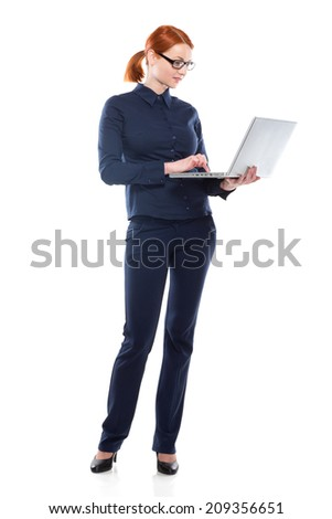 Businesswoman with laptop isolated on a white background.Concept of leadership and success. - stock photo