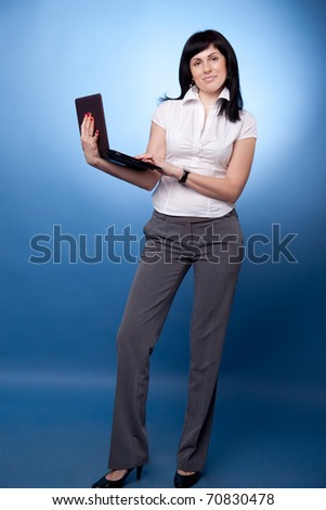 Businesswoman with laptop on blue background