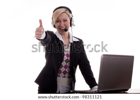 Businesswoman with Laptop thumbs up - stock photo