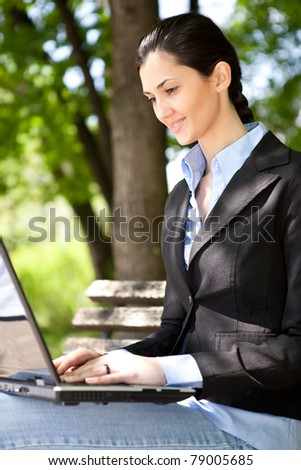 businesswoman with laptop working outdoor - stock photo