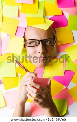 Businesswoman with lots of reminder notes - stock photo