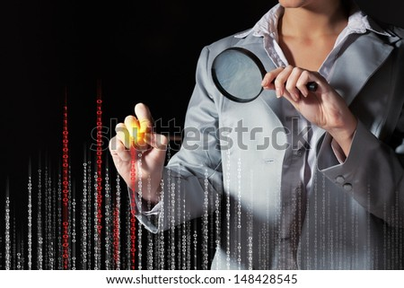 Businesswoman with magnifier glass examining binary code - stock photo