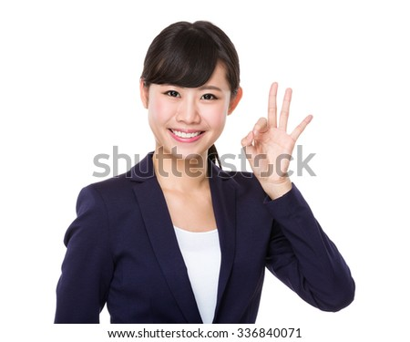 Businesswoman with ok sign gesture - stock photo