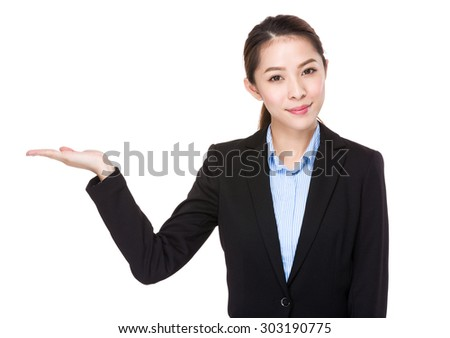 Businesswoman with open hand palm for showing something - stock photo