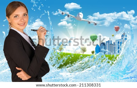Businesswoman with pen looking at camera - stock photo