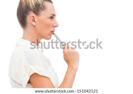 Businesswoman with pen on mouth looking to the right