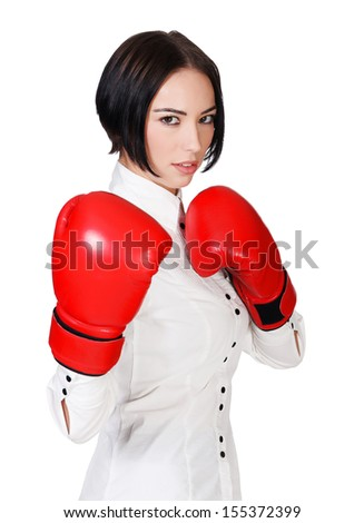 Businesswoman with red boxer gloves, white background, copyspace  - stock photo