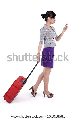 Businesswoman with red suitcase and holding a mobile phone - stock photo