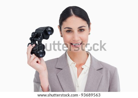 Businesswoman with spy glasses against a white background - stock photo
