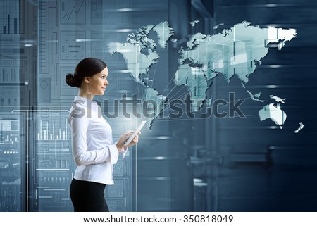 Businesswoman with tablet pc against high tech blue background - stock photo
