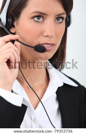 Businesswoman with telephone head set - stock photo