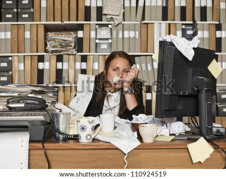 Businesswoman with the flu at the office - stock photo